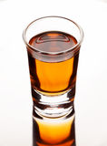 Single shot of alcohol drink on a metal stand Royalty Free Stock Image