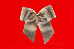 Single silver bow isolated on red Stock Photo