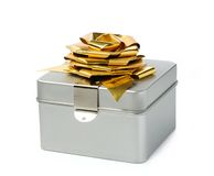 Single silver gift box with golden ribbon Royalty Free Stock Photography