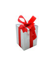 Single silver gift box with red ribbon isolated on white backgro Royalty Free Stock Images
