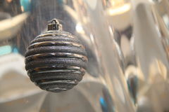 Single silver ornament hanging in window Stock Photos