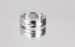 Single silver ring on mirror Stock Image