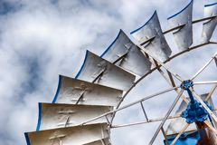 Single silver windmill up close. A detailed view of a single old historic wind wheel or wind pump made of metal up close stock photo