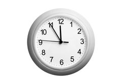 A single simple clock showing the time Stock Photos