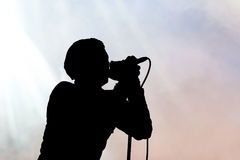 Single Singer In Silhouette Royalty Free Stock Photo