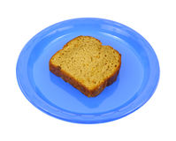 Single slice of carrot cake on a blue plate Stock Images