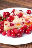 Single slice of fruit pie and several berries around. Vertical photo of fruit pie on white plate among heap of red juicy cherries and sweet raspberries. Single royalty free stock images