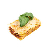Single slice of lasagna isolated Stock Images