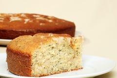 Single slice of lemon poppy seed cake Royalty Free Stock Photos