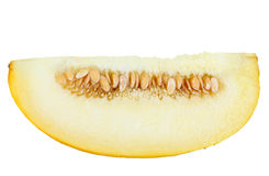 Single slice of ripe yellow melon Stock Photos