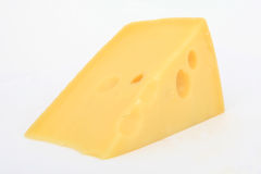 Single slice of Swiss cheese. A slice of plain yellow swiss cheese Royalty Free Stock Images