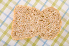 Single slice of wholemeal bread on linen cloth Royalty Free Stock Images