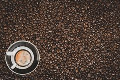 Single espresso coffee cup on coffee beans background stock photos