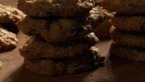 Oatmeal chocolate chip cookies on a wooden cutting board stock video footage