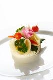 Single snack on white dish Stock Photo