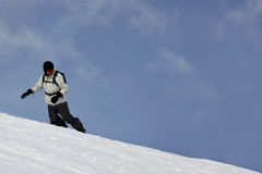 Single Snowboarder Sliding Stock Images