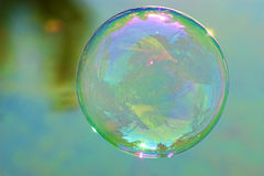 Single soap bubble. Close-up of a soap bubble in the air Royalty Free Stock Photography