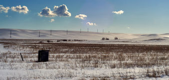 Single Solitary Hut and Winter Landscape and Pylons Stock Image
