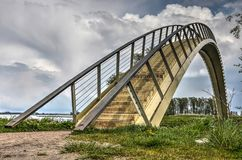 Single span arch bridge. The Ooypoort pedestrian bridge, at the time of construction the longest single-span composite bridge in the Netherlands gives royalty free stock photography