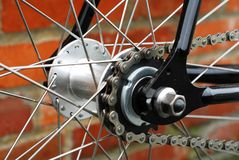 Single speed bicycle chain and spokes. Detail shot of a single speed bike, black Royalty Free Stock Photos