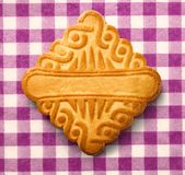 Single square biscuit in closeup Stock Photo