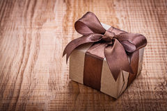 Single square vintage gift box qith brown bow on Stock Image