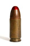 Single standing  tracer 9mm  cartridge isolated. Single standing red-tipped tracer 9mm Parabellum cartridge isolated Stock Images