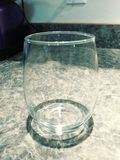 Single Stemless Wine Glass. On a counter royalty free stock images