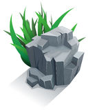 Single stone with grass Stock Photo