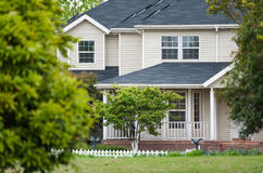 Single-story bungalow surrounded by trees stock photography