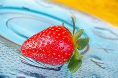 Single strawberry Stock Images