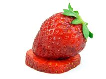 A single strawberry on a slice Stock Images