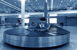 Single suitcase alone on airport. Carousel Royalty Free Stock Photography