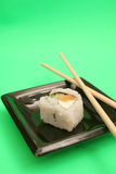 Single sushi on green vertical royalty free stock image