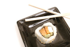 Single sushi on white on top. Shot of single sushi on white on top Royalty Free Stock Photo