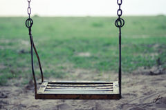Single Swing with green grass Stock Image