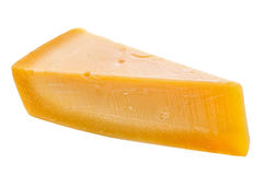 Single tasty fresh yellow big segment piece of parm cheese is is Royalty Free Stock Images