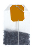Single tea bag with string and tag. Royalty Free Stock Photos