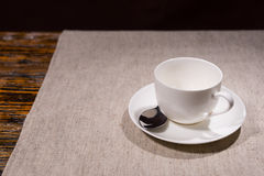 Single teacup and saucer with spoon Stock Photo