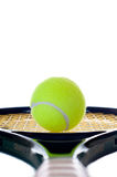 Single tennis ball looking down the handle Royalty Free Stock Photos