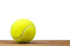 Single tennis ball table wood isolated Stock Images