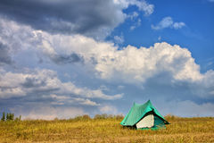 Single tent in the field Royalty Free Stock Photography