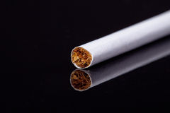 Single thin cigarette isolated on black background macro Stock Photos