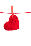 Single thread heart. On a red string isolated on white background Royalty Free Stock Photos