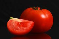 Single tomato isolated on black background Royalty Free Stock Images