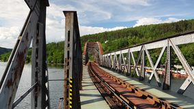 Single track railway bridge over the Vltava river stock video