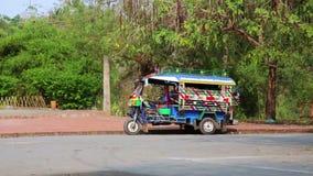 Single tuk tuk on road,Luang Prabang,Laos stock footage
