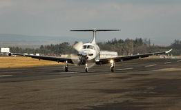 Single turboprop aircraft, airplane taking off Stock Photos