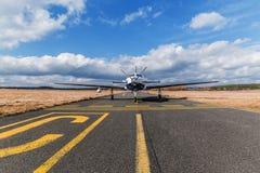 Single turboprop aircraft  on airport Pribram. Stock Photos
