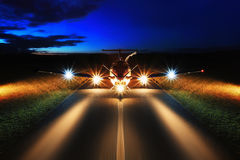 Single turboprop aircraft on the groun. Night Royalty Free Stock Image